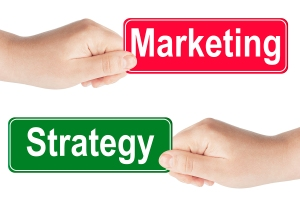 Strategy and Marketing traffic sign in the hand
